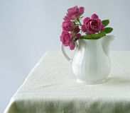 Bouquet of small roses. In a ceramic milk pitcher Royalty Free Stock Photography