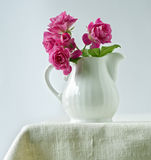 Bouquet of small roses. In a ceramic milk pitcher Royalty Free Stock Images