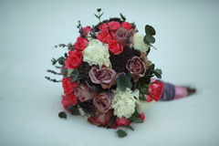 Bouquet in the snow Royalty Free Stock Photo