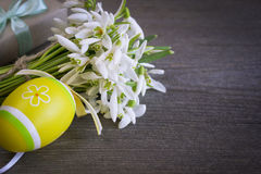 Bouquet of snowdrops flowers with easter eggs Royalty Free Stock Images