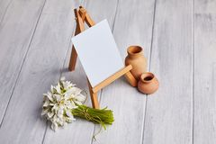 Bouquet of snowdrops and a small easel stock image