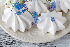 Bouquet spring flowers, coffee cup, marshmallows on wooden Royalty Free Stock Photo