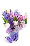 Bouquet spring flowers with decorative butterfly Stock Photo