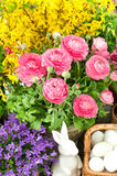 Bouquet of spring flowers with easter decoration Stock Photo
