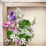 Bouquet of spring flowers on a vintage background Stock Images
