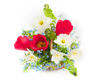 Bouquet of spring flowers in a wattled basket Royalty Free Stock Photography