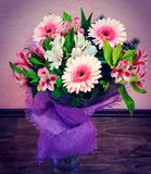 bouquet of spring flowers - white and pink Alstroemeria and gerberas with green leaves in gentle pink tones Stock Photo