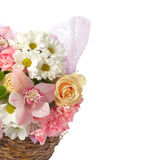 Bouquet of spring flowers in a wicker basket isolated Stock Photo
