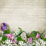 Bouquet of spring flowers on a wooden vintage background Royalty Free Stock Images