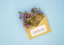 A bouquet of spring wildflowers in an envelope and the inscription thank you to the doctor and nurses