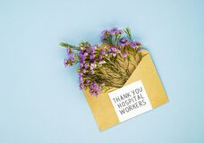 A bouquet of spring wildflowers in an envelope and the inscription thank you to the Jerusalem workers