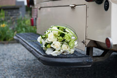 Bouquet on the stair of an oldtimer Stock Photography