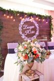 Bouquet standing in a vase on a table. Flower arrangement at a wedding banquet. stock photography