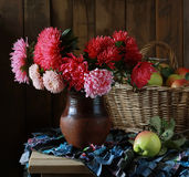 Bouquet. A still life with asters, a still life with apples Royalty Free Stock Photo