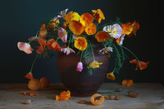 Bouquet. Still life with flowers and berries Stock Photos