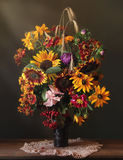 Bouquet. Still life with bouquet of flowers, berries and cereals Royalty Free Stock Image