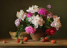 Bouquet. Still life with peonies and strawberries Stock Images