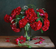 Bouquet. Still life with a bouquet of roses and wild flowers Stock Photo