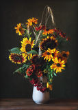 Bouquet. Still life with a bouquet of sunflowers and cereals Royalty Free Stock Images