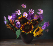 Bouquet. Still life with sunflowers and other flowers Royalty Free Stock Photos