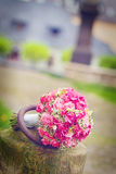Bouquet on stone. Wedding bouquet on stone in garden Royalty Free Stock Photo