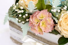 A bouquet of sugar flowers in a wooden white box. Royalty Free Stock Photo