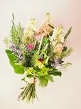 Bouquet of summer flowers. Bouquet of fresh summer flowers with earth of corn on white -pink background Royalty Free Stock Photography