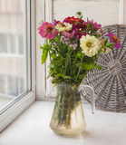 Bouquet of summer flowers on window Royalty Free Stock Photography