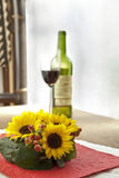 Bouquet of sunflowers. On a table and wine Royalty Free Stock Images