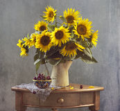 Bouquet of sunflowers and cherry Royalty Free Stock Photos