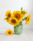 Bouquet of sunflowers. In old ceramic jug on   wooden table Stock Images