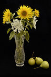 Bouquet of sunflowers and pears. Bouquet of sunflowers in a vase and pears Royalty Free Stock Photography