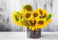 Bouquet sunflowers Still life old tin Stock Photo