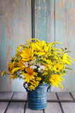 Bouquet of sunflowers and wild flowers on wooden table Stock Photos