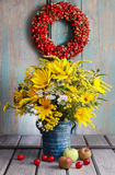 Bouquet of sunflowers and wild flowers on wooden table Royalty Free Stock Photography