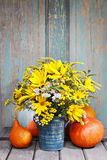 Bouquet of sunflowers and wild flowers on wooden table Stock Images