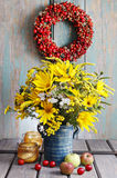 Bouquet of sunflowers and wild flowers on wooden table Stock Photography