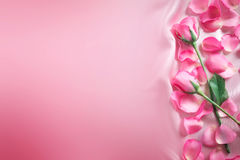 bouquet sweet pink roses petal on soft pink silk fabric , romanc Stock Photo