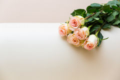 Bouquet of tea roses on a white sofa.  Royalty Free Stock Photography