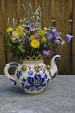 Bouquet in a teapot Stock Image