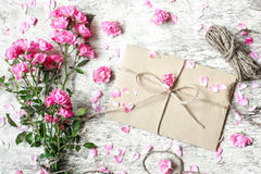 Bouquet of tender pink roses with envelope and rope Stock Images