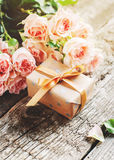 Bouquet of Tender Pink Roses and Gift Box Stock Image