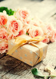 Bouquet of Tender Pink Roses with Present Box Royalty Free Stock Image