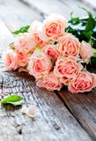 Bouquet of Tender Pink Roses on Wooden Table Royalty Free Stock Images