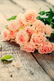 Bouquet of Tender Pink Roses on Wooden Table, Royalty Free Stock Photos