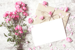 Bouquet of tender roses with a blank greeting card and envelope Royalty Free Stock Image