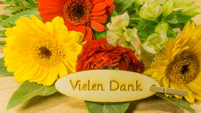 Bouquet with text in German. Thank you very much royalty free stock images