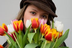 Bouquet of tulips. Girl with big eyes and a bouquet of tulips Royalty Free Stock Photography