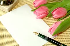 Bouquet of tulips with blank card and pen Royalty Free Stock Photo