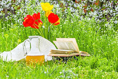 Bouquet of tulips, books and white hat Royalty Free Stock Photos